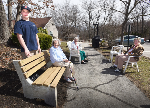 "BRYAN EATON/Staff photo. Boy Scout Zachary Wendt with, from left, Rita Connelly, Mary Jane Dushene and Dianne Finnegan, stands next to one of five benches he build at Byfield Eldery Housing for his Eagle Scout project. The benches were dedicated to deceased Byfielders Stephen Cunningham; Worthen ""Brownie"" Taylor; John Short and Robert ""Tubby"" Rogers."