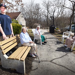 BRYAN EATON/Staff photo. Boy Scout Zachary Wendt with, from left, Rita Connelly, Mary Jane Dushene and Dianne Finnegan, stands next to one of five benches he build at Byfield Eldery Housing  ...