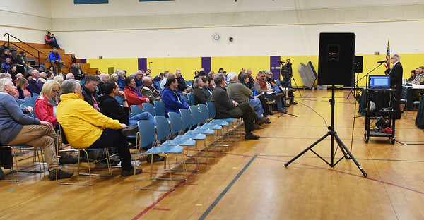 BRYAN EATON/Staff photo. Newbury town meeting conducts their business in the gymnasium of the elementary school on Hanover Street.