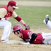 JIM VAIKNORAS photo Gloucester's Matt Heckman dives safely back to first just under the tag of Newburyport's Jaden Medeiros during their game at Stage Fort Park Saturday.