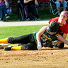 JIM VAIKNORAS/staff photo Amesbury's Ashlee Porcaro tags out a runner at 3rd against North Reading Friday afternoon at Perry Field in Amesbury.
