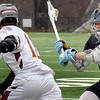 BRYAN EATON/Staff photo. Newburyport's Hunter McCoy moves the ball with Triton's Bryan Wideberg in pursuit.