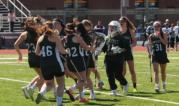 JIM VAIKNORAS photo  Pentucket girls lacrosse team celebrates their victory over Triton at Triton Friday.