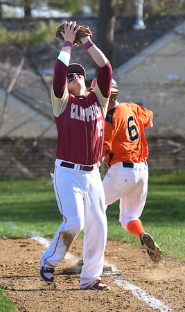 BRYAN EATON/Staff photo. Newburyport's Jayden Medeiros catches an Ipswich pop up.