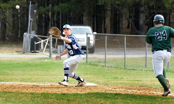 BRYAN EATON/Staff photo. Triton first baseman Travis Madden has the throw forcing Pentucket's Nathan McCarthy out.