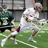 BRYAN EATON/Staff photo. Austin Prep's JJ Harding knocks the ball from Newburyport's Cullen Heath.