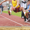 BRYAN EATON/Staff photo. Newburyport's Donte Harmon in the triple jump.