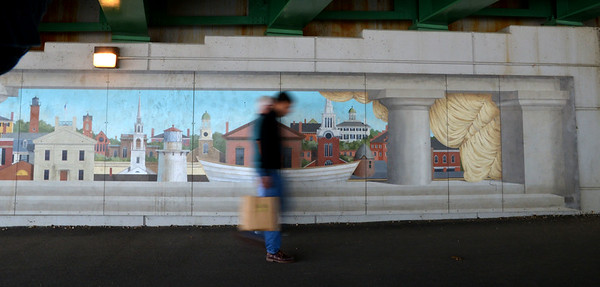 JIM VAIKNORAS/Staff photo A man walks along the Rail Trail under the Gillis Bridge Saturday morning.