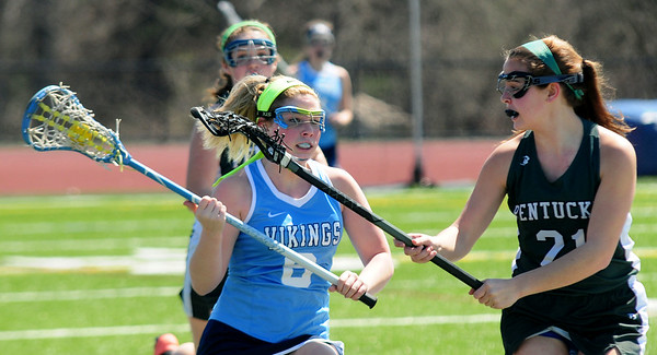 JIM VAIKNORAS photo  Pentucket's Talia Beech tries to knock the ball away from Triton's  Erica Siemasko  at Triton Friday.
