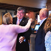 BRYAN EATON/Staff photo. Robert J. Cronin, candidate for Newburyport mayor, greets supporters at a kickoff campaign event at the Grog last night. The city councilor is taking on incumbet mayor Donna Holaday with nomination papers not to close until August.