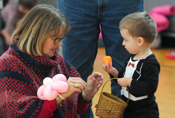 JIM VAIKNORAS photo James Coursas, 2, shows his aunt Susan Carroll an egg he found during the Annual Easter celebration at Salisbury Elementary School sponsored by the Salisbury Parks and Recreation Commission Saturday.