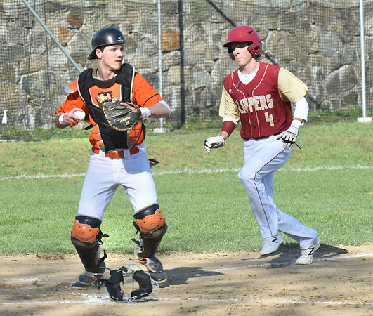 BRYAN EATON/Staff photo. Ipswich catcher forced Newburyport's Tom Furlong out with a throw from his pitcher Jake Kivekas who grabbed the ball.