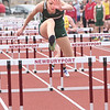 BRYAN EATON/Staff photo. Pentucket's Saige Tudisco in the 100 hurdles.