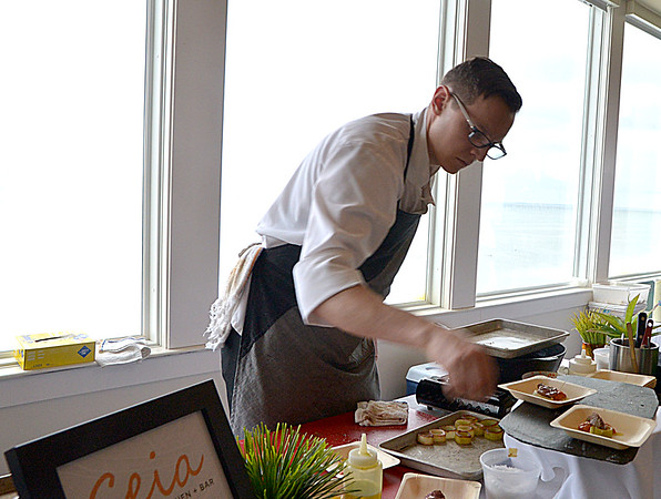 JIM VAIKNORAS photo Executive chef Jeremy Glover of Ceia prepares a beef dish at the Great Chef's Night at Blue Ocean on Salisbury Beach to benefit  the Anna Jaques Aid Society