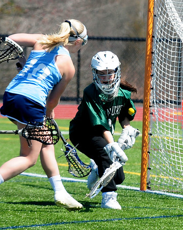 JIM VAIKNORAS photo  Pentucket's Vanessa Franco makes a stop on Triton's Samantha Brown at Triton Friday.