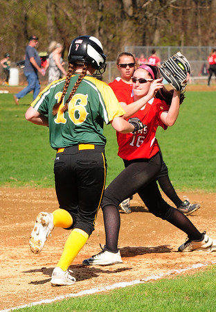 JIM VAIKNORAS/staff photo Amesbury first baseman Mikayla Porcaro pulls in a throw for an out against North Reading riday afternoon at Perry Field in Amesbury.