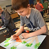 "BRYAN EATON/Staff photo. Zachary Bell, 7, decorates his cardinal in the ""Birds and Birches"" project in Pam Jamison's art class at the Bresnahan School on Monday morning. The was a tie in to the recent Earth Day."