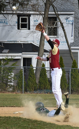 BRYAN EATON/Staff photo. Newburyport second baseman reaches for the throw but Pentucket's Jacob Deziel is safe on the steal.
