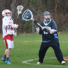 BRYAN EATON/Staff photo. Triton goalie # 53 looks for an open teammate as a Masconomet player moves in.