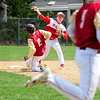 JIM VAIKNORAS/staff photo Mascomonet's Andrew Manni turns a double play as Newburyport's Ken Hodge dives into 2nd during their game at Pettingell Park in Newburyport Thursday.