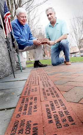 BRYAN EATON/Staff photo. Veteran's agent Kevin Hunt, left, and Rich Banks are selling bricks for people to put names of their deceased relatives who served in the armed forces. The proceeds will be used to repair veteran's monuments.