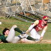 JIM VAIKNORAS photo Newburyport's kevin Murphy tags out North Reading's Jeff Mejia during their game at Pettingell Park in Newburyport Thursday.
