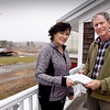 BRYAN EATON/Staff photo. Cindy Yetman with Cider Hill Farm co-owner Glenn Cook.