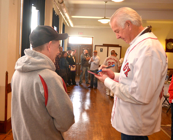 JIM VAIKNORAS photo Tom Hanshaw of Amesbury gets a autograph from Red Sox great Jim Lonborg during Red Sox day at the Masonic Temple in Newburyport Saturday.