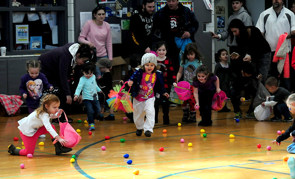 JIM VAIKNORAS photo Kids rush to collect eggs at the Annual Easter celebration at Salisbury Elementary School sponsored by the Salisbury Parks and Recreation Commission Saturday.