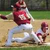JIM VAIKNORAS/staff photo Mascomonet's Jack Seymore dives back to 1st as Newburyport's Jaden Medeiros waits for the throw during their game at Pettingell Park in Newburyport Thursday.