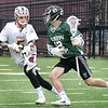 BRYAN EATON/Staff photo. Newburyport's Owen Bradbury defends against Austin Prep midfielder Michel Chabr.