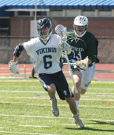 JIM VAIKNORAS photo Triton's Colby Buccheri makes a move past Pentucket's Eddie Beard during their game  at Triton Friday.