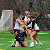 JIM VAIKNORAS photo Triton's Samantha Brown looses control of the ball after getting hit in the face during the Viking's games against Newburyport a War Memorial Stadium in Newburyport Friday. Newburyport was assessed a penalty on the play.