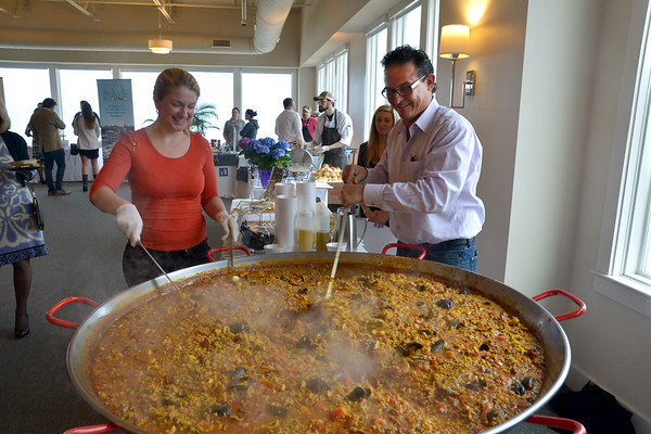 JIM VAIKNORAS photo Kerri O'Neill and Wellington Augusto of the Mission Oak Grill in Newburyport stir  paella in a 60 inch paella pan at the Great Chef's Night at Blue Ocean on Salisbury Beach to benefit  the Anna Jaques Aid Society