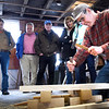 BRYAN EATON/Staff photo. Douglas Brooks uses Japanese chisels as he gives a demonstration of that country's boat building at Lowell's Boat Shop in Amesbury on Wednesday afternoon. The author's demonstration and book signing was part the organization's Speaker Series.