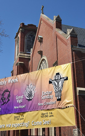 BRYAN EATON/Staff photo. Several churches in the area, including All Saint's Church in Amesbury, have information displayed about their Easter Weekend events.