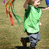 BRYAN EATON/Staff photo. Mason Fontaine, 3, and his fellow pre-kindergartner run around Newburyport's Waterfront Park on Monday morning waving colored streamers. The Newburyport Montessori School children went to the park for their free time since the weather was so nice.