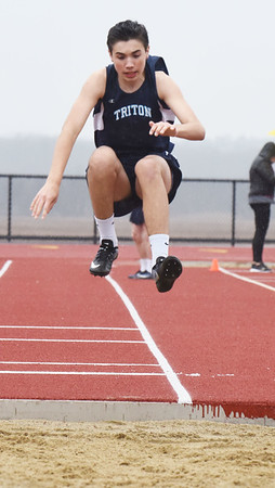 BRYAN EATON/Staff photo. Triton's Nick Doring in the triple jump.