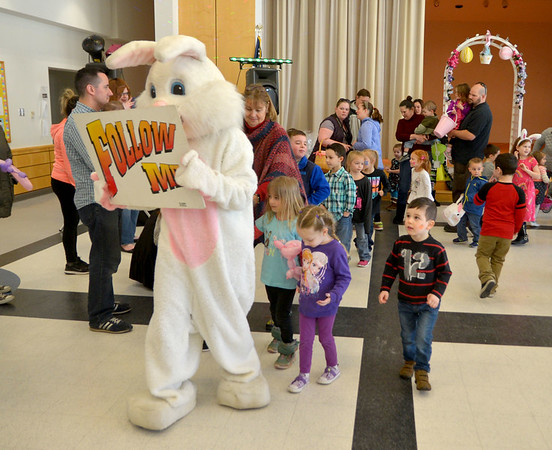 JIM VAIKNORAS photo The Easter Bunny leads a line of dancer doing the bunny hop during the Annual Easter celebration at Salisbury Elementary School sponsored by the Salisbury Parks and Recreation Commission Saturday.