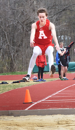 BRYAN EATON/Staff photo. Amesbury's John Sydlowski in the long jump at Pentucket High.