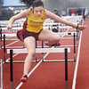 BRYAN EATON/Staff photo. Newburyport's Emma Cutter jumps in the 100 yard hurdles.
