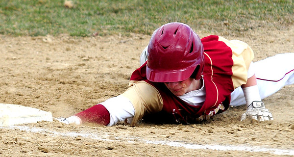 JIM VAIKNORAS photo Newburyport's Tommy Furlong dives back to first against Gloucester during their game at Stage Fort Park in Gloucester Saturday.