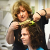 "BRYAN EATON/Staff photo. Volunteer Denise Nalesnik gives ensemble performer Hallie Livengood a 1913 hairstyle for the Triton High School production of ""Hello My Baby."""