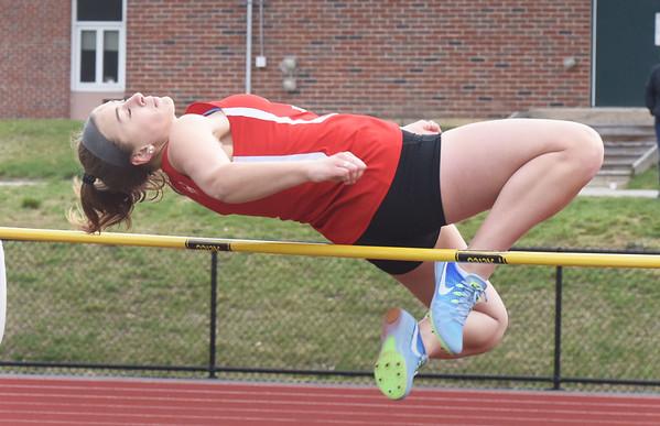 BRYAN EATON/Staff photo. Amesbury's Emma Richardson clears the high jump.
