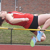 BRYAN EATON/Staff photo. Amesbury's Emma Richardson clears the high jump.