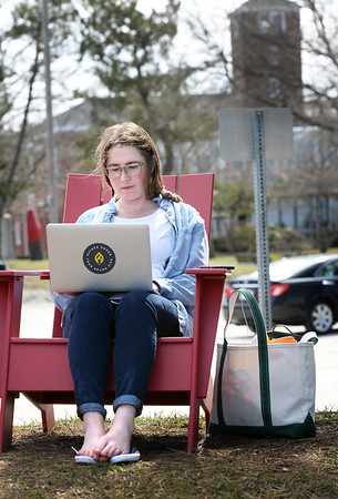 "BRYAN EATON/Staff photo. With shoes off, Andrea Logan of South Eliot, Maine works on her laptop at the Newburyport waterfront. She works at Ember, an event planning company in downtown, and decided to make her ""office"" outside with the warm weather."