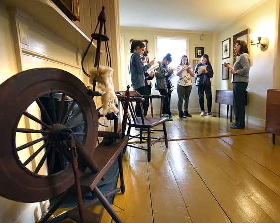 BRYAN EATON/Staff photo. Docent Nan Becker shows the bedroom where John Greenleaf Whittier's mother lived, the wall being torn down and the space added to his study. River Valley Charter School students were visiting the Amesbury home of the famous poet.