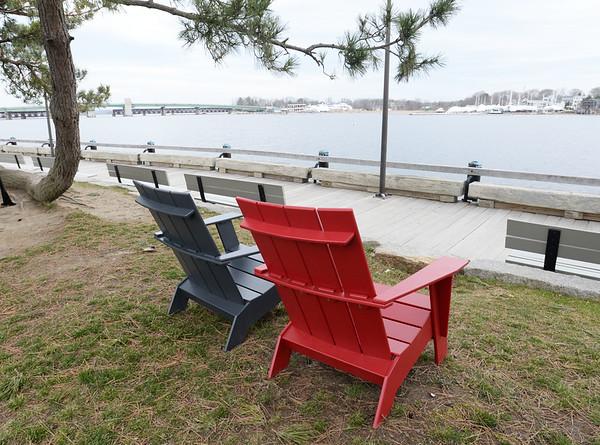 BRYAN EATON/Staff photo. Adirondack chairs have been put along Newburyport's waterfront.