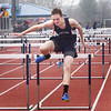 BRYAN EATON/Staff photo. Triton's Chris Brennan in the 100 yard hurdles.