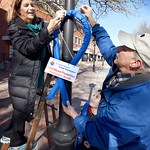 BRYAN EATON/Staff photo. Several members of the Exchange Club of Greater Newburyport put up around 50 blue ribbons around downtown Newburyport Friday morning to be displayed for two weeks to ...